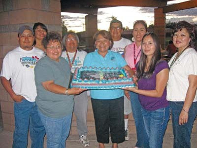 <i>Tyler Tawahongva/NHO</i><br> From left to right: Mike Yellowhair (Transfer Station), Patricia Begay (Library), Delmar Polacca (Library), Gene Flatrock (Transfer Station), LeAnn Johnson (County Health), Trish Polacca (Library), Supervisor Lena Fowler (holding cake), Loreal Scott (County Supervisor Assistant) and Luvina Bilagody (County Supervisor Assistant).