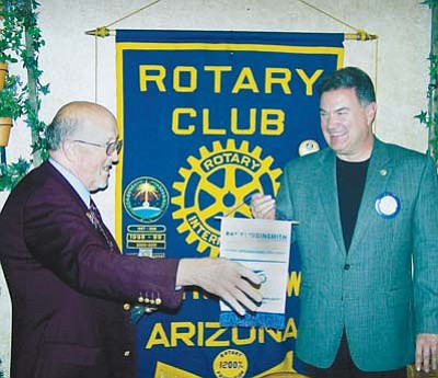 <i>Todd Roth/NHO</i><br> Rotary District Governor Glenn Smith (at left) presents Winslow Rotary President Paul Ferris, with an award.