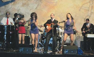 <i>Rosanda Suetopka Thayer</i><br> Micky Cruz entertains fans at the 2010 Native Roots and Rhythm Festival, which was held at the Buffalo Thunder Casino and Resort. The event coincided with the 2010 Santa Fe Indian Market.