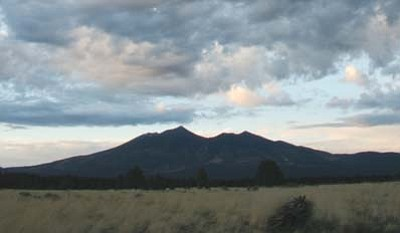 """<i>Photo courtesy of Calvin Johnson</i><br> The sacred San Francisco Peaks is known by many other names. To the Navajo, it's Dook'o'osliid (""""The Place Where the Snow Never Melts"""") while the Hopi call the Peaks Nuvatukya'ovi (""""The Place of Snow on the Very Top""""). Other tribal names include Tsii Bina (""""Protection Shrine,"""" Acoma), Dzil Tso (""""Big Mountain,"""" Apache), Wikagana pa'dja (""""Snowy Mountain,"""" Havasupai), Wik' hanbaja (""""Snowy Mountain,"""" Hualapai), Wimonogaw'a (""""Cold Mountain,"""" Yavapai), and Sunha:kwin K'yaba:chu Yalanne (""""Mountain with the Volcanic Water Caches,"""" Zuni Pueblo)."""
