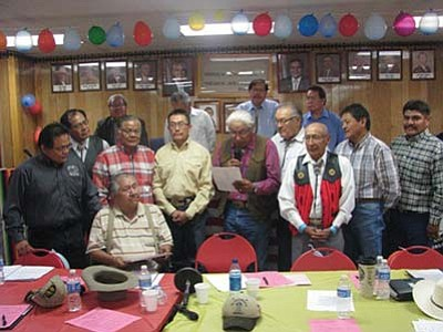 <i>Photo by Alastair Bitsoi</i><br> Council Delegate Leslie Dele (center, with microphone), a member of the TCDC, reads the land use plan certification proclamation as Houck Chapter Officials, CLUPC members and TCDC members look on.