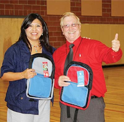 <i>Photo by Laphillda Tso</i><br> Navajo Nation Councilwoman Hope McDonald Lone Tree stands with a very pleased Tuba City Boarding School Principal Don Coffland. MacDonald Lone Tree's efforts resulted in the Office Depot Foundation donating 4,000 backpacks to students across the Western Navajo Reservation.