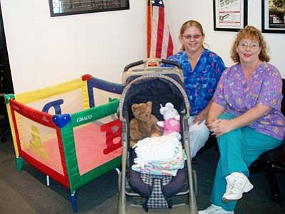 <i>Courtesy photo</i><br> CollegeAmerica instructor Tammi Richards, RN, BSN, donated items to a young student who was in need of baby supplies for her newborn. A fellow student from Tammi's class made and donated the hand-made baby blankets in the stroller.