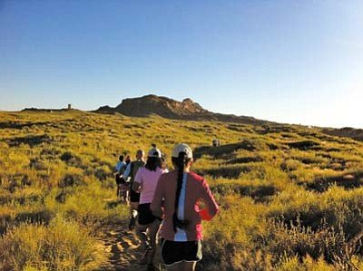 <i>Rosanda Suetopka Thayer</i><br> Runners blaze a trail during the historic <i>Paatuwa'qatsi</i> Run through ancient mesa back roads near Walpi, Sichomovi and Hano. The sun was just coming up over the mesa top when the runners left their starting point.