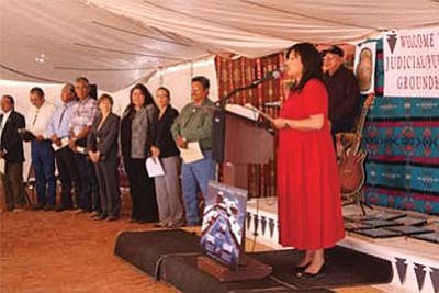 <i>Photo by Laphilda Tso</i><br> Navajo Nation Council Delegate Hope MacDonald Lone Tree, member of the Public Safety Committee, speaks at the groundbreaking of the Tuba City Justice Center as key officials of the collaboration effort, including President Joe Shirley Jr., look on.