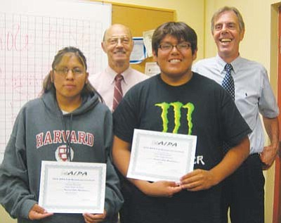 Hopi High radio students Donna Brooks and Dion Sahneyah receive congratulations from Hopi Jr/Sr High Superintendent Paul Reynolds and Principal Glenn Gilman for winning awards from the Arizona Interscholastic Press Association.