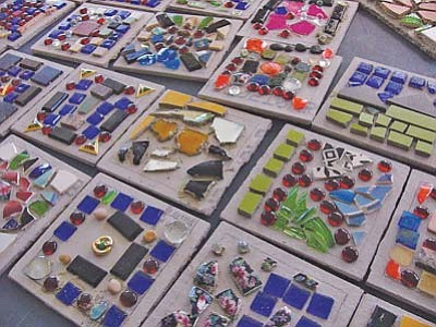 <i>S.W. Benally/NHO</i><br> Preliminary layout of mosaic tiles made by STAR students await gluing. The tiles will be grouted and put in place; the project is expected to be completed by Thanksgiving.