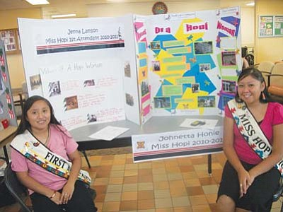 <i>Tyler Tawahongva/NHO</i><br> Miss Hopi Johnetta Honie and First Attendant Jenna Lamson sit at their booth during the Women's Health Fair.