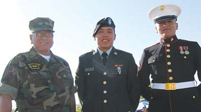 <i>Tyler Tawahongva/NHO</i><br>Veterans stand proudly at attention in preparation for the Western Navajo Fair parade.