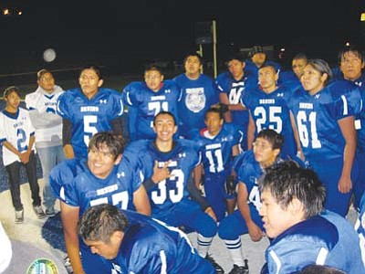 <i>Stan Bindell/NHO</i><br> The Hopi High football team celebrates their 13-8 homecoming victory over Greyhills Academy.