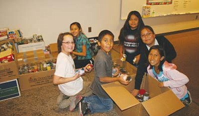 <i>Submitted photo</i><br> From left to right: Noah Richardson, Kaly Arvizu, Jarmon Macumn, Trey Uentillie, Chanel Coolie and Natasha Huskon happily pack some of the donated food items.