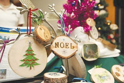 <i>Courtesy photo</i><br> Holiday ornaments made from small diameter pines send a message of environmental sustainability, store greenhouse gases and send youth to forestry camp.