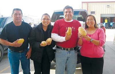 <i>Courtesy photo</i><br> Mike Sweat (third from left) donated bags of potatoes from Hopi Outreach to the Hopi High School National Honor Society food drive for the elderly. Joining him, from left, former school board member Wallace Youvella Sr., Hopi High Student Council President Torri Youvella and NHS advisor Lavonne Adams.