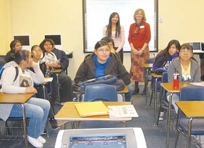 <i>Stan Bindell/NHO</i><br> Navajo Times reporter Candace Begody (left, standing) and University of Arizona Journalism Outreach Instructor Lisa Button talk to Hopi High journalism students.