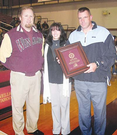 <i>Todd Roth/NHO</i><br> DPS officer Gordon Beyer (right) was honored by Winslow High School. An award was given by Principal Chris Gilmore (left) in honor of his service to the community of Winslow. Beyer's wife (center) was in attendance as well. Beyer will be transferring to Tucson at the end of the month.