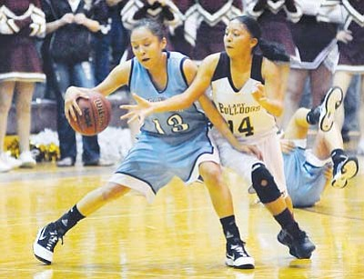 <i>Todd Roth/NHO</i><br> A Winslow Lady Bulldog player defends against a Window Rock Lady Scout player during the championship round of the Winslow Winter Classic. The Lady Scouts emerged as the champions with a final score of 52-45.