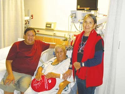 <i>FMC courtesy photo</i><br> From left: Tully Frank Jr., patient Tully Yellowman and his wife Susie Yellowman. Tully Yellowman became the 1,000th open heart surgery patient at Flagstaff Medical Center last month.