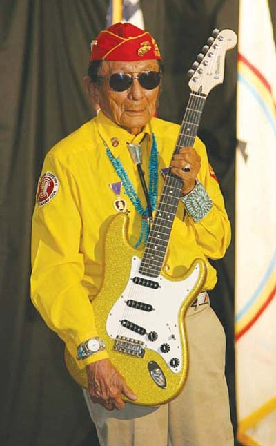 <i>Courtesy photo</i><br> Navajo Code Talker Samuel Tom Holiday holds up a one-of-a-kind guitar created by Navajo artist Shonie De La Rosa in honor of the Navajo Code Talkers and their distinguished military service during WWII. The guitar, which will be signed by all surviving Navajo Code Talkers, will be placed on display at the Navajo Code Talkers Museum in Window Rock.