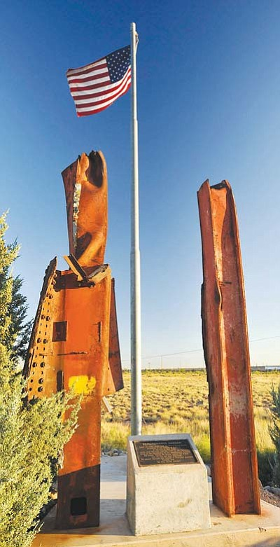 <i>Todd Roth/NHO</i><br> Two massive steel beams from the World Trade Center stand solemnly as a reminder of the tragedy that occurred on Sept. 11, 2001. The beams, which are part of a 9-11 memorial in Winslow, are scheduled to be moved to another location to allow for proposed expansion of Transcon Lane by the Arizona Department of Transportation. The new memorial is scheduled to be completed in time for the 10-year anniversary of the Sept. 11 memorial service scheduled to take place in Winslow on Sept. 11.