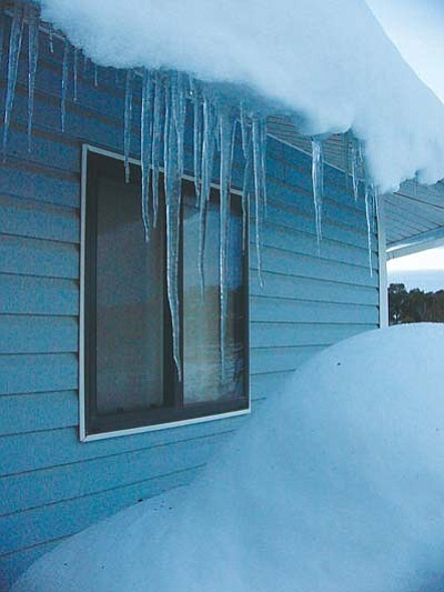 S.W. Benally/NHO<br /><br /><!-- 1upcrlf2 -->Icicles and snow outside a Forest Lake window hints that roads remain snow packed and icy.