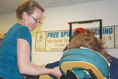 <i>Courtesy photo</i><br> A customer enjoys a chair massage at the CollegeAmerica Health and Career Fair held Jan. 14.