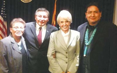 <i>Photo by Eric Descheenie</i><br> Left to right: Navajo Nation First Lady Martha Shelly, Navajo Nation President Ben Shelly, Gov. Jan Brewer and Speaker Pro Tem Jonathan Nez at the 16th Annual Indian Nations and Tribes Legislative Day in Phoenix.