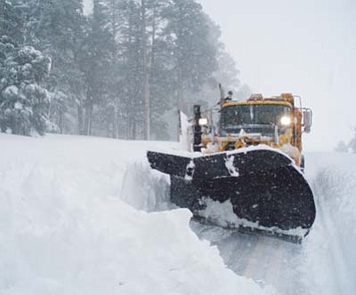 <i>ADOT courtesy photo</i><br> Snowplows help keep roads and freeways clear of ice and snow during the winter months, but it doesn't come cheap. To date, ADOT has spent close to $1.7 million in labor, materials and equipment for snow and ice removal.