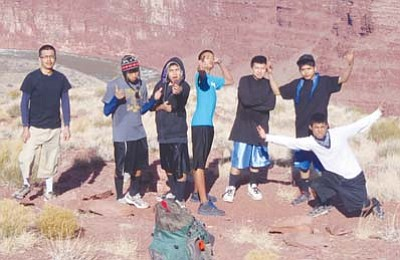 <i>Photo by John Wehrman</i><br> Holbrook High School Running Club members pictured left to right: Kanasa Gaddy (HHS alumni), Gregory Begay, Terrell Twobulls, Noelan James, Ian Qumyintewa, Dominic Sinquah, and Michael Shorty.