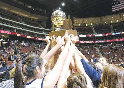 <i>Anton Wero/NHO</i><br> <b>STATE CHAMPS:</b> Members of the Window Rock Lady Scouts hoist the 2011 Arizona State Girls 3A trophy in the air after defeating the Monument Valley Lady Mustangs 41 to 20 during the Arizona State 3A Championship Game in Glendale.