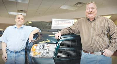 <i>Todd Roth/NHO</i><br> Brothers Peter (left) and Harvey Cake run Cake's Car Company (formerly Cake's Chevrolet) in Winslow. Cake's is currently celebrating their 83rd year in business, selling Dodge, Nissan and Jeep vehicles.