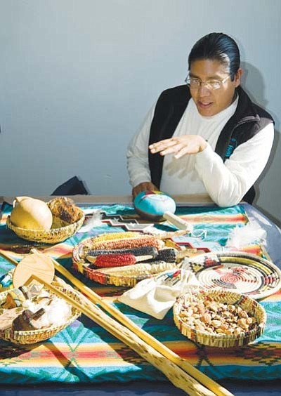 <i>DuaneDarling.com photo</i><br> Hopi anthropologist Micah Lomaomvaya explains some of the many food and utilitarian uses of traditional crops that are grown at Hopi, in addition to the various wild plants. Besides corn, there is also yucca, gourds, sunflowers, greasewood and even cotton.