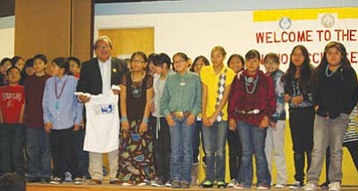 <i>Courtesy photo</i><br> Navajo Nation Council Speaker Johnny Naize (with T-shirt) stands with a number of Navajo students participating in the 2011 Navajo Nation Science Fair, which was held at the Diné Education Center auditorium last Wednesday.