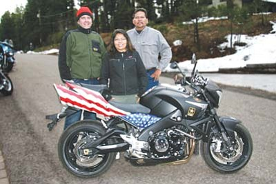 <i>NHHR photo</i><br> Chris Muhlenfeld, Shelly Begay and Larry Noble stand with the grand prize in this year's Navajo Hopi Honor Riders (NHHR) raffle — a custom-painted Suzuki B-King 1340. Tickets are currently on sale with all proceeds going to benefit the NHHR for their ongoing work in recognizing Native American veterans.