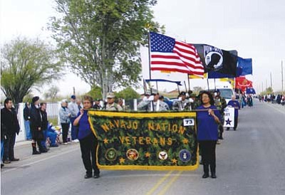 <i>Photo by Pat Carr</i><br> A parade commemorating the 66th Anniversary of the Iwo Jima flag raising was held in Sacaton on Feb. 26.  Eloise Tsosie and Elizabeth Tsosie led a marching unit from the Central Navajo Veterans  Organization and Auxiliary in Chinle.