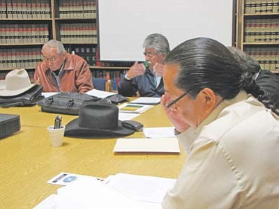 <i>Courtesy photo</i><br> From left: David John representing the Diné Medicine Men Association, Dr. Anthony Lee representing the Diné Hataalii Association and Lavonne Henry representing DNA Legal Services and other Navajo human rights officials listen to Toni Stanger, Program Specialist for the USDA Office of Tribal Relations via teleconference on March 3 at the DNA Legal Services conference room in Window Rock.
