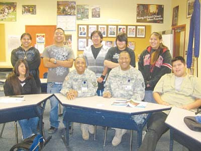 <i>Stan Bindell/NHO</i><br> Hopi Jr/Sr High JROTC greets their new instructor, Sgt. James Logan. From left (upper row): Elsha Dosela, Marty Adams, Shelden Nanacasia, Gabriella Tovar and Halli Lomayaktewa. Front row: LaKayla Adams, Major Phillip Taylor, Sgt. Logan and Keith David.