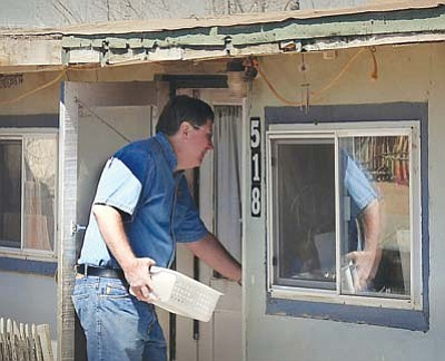 <i>Todd Roth/NHO</i><br> Winslow Mayor Robin Boyd delivers a hot meal to a local elder as part of a nationwide event called Mayors for Meals Day. Boyd was joined by Councilman Marshall Losey (pictured below) as they went door to door delivering meals.