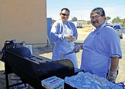 "<i>Rosanda Suetopka Thayer/NHO</i><br> Wayne ""Muppy"" Sekaquaptewa (left) who serves as Hopi Tel's Central Office Technician was a master at grilling over 100 burgers and hot dogs at the Hotevilla Appreciation Lunch along with his ""assistant burger chef"" for the day, Paul Redington (right), who is the Central Office Supervisor at Moencopi."