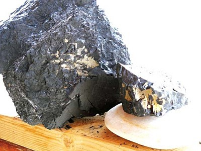 "<i>Rosanda Suetopka Thayer/NHO</i><br> Flecks of iron pyrite can clearly be seen in chunks of coal being hauled from the Peabody Mine for home heating use by both Hopis and Navajos. The burning of coal to heat homes was more prevalent than ever this past year, but there is currently no information available as to any possible hazards to humans from the burning of iron pyrite, which was once used as a source of ignition for firearms. Iron pyrite, which can sometimes take on a golden color, is also known as ""Fool's gold."""