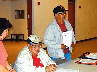 "<i>Rosanda Suetopka Thayer/NHO</i><br> Jerry Sekayumptewa (seated), Phillip Quochytewa and Mary Felter (at far left) acted as moderators for a meeting held by the Hopi ""Silent Majority"" group, who met last Wednesday at the Hotevilla Youth and Elderly Center to present their concerns about alleged constitutional violations by Hopi Chairman LeRoy Shingoitewa."