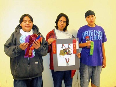 <i>Stan Bindell/NHO</i><br> The Hopi High art award winners are Rodriguez Poleahla, Hector Koyawena and Dallas Fred.