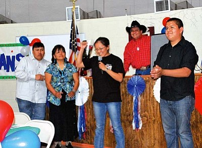 <i>Courtesy photo</i><br> Sgt. Karla Curley (center) addresses family and friends during a recent gathering held in her honor. On stage with her are (from left) Kyle Curley, mother Patricia Yazzie, Kevin Curley and event emcee Thomas Yazzie. Sgt. Curley had just returned from a 12-month tour of duty in Iraq.