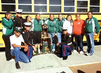 <i>Courtesy photo</i><br> Cadets from the Marine Corps Junior Reserve Officer Training Corps (MCJROTC) from Tuba City High School pose in front of their bus with their trophy. The MCJROTC Drill Team recently competed in the Desert Classic JROTC Arizona State High School Drill Championship in Phoenix and won the Championship Sweepstakes trophy for the fifth time since 2003, maintaining the legacy of the Tuba City Warriors.