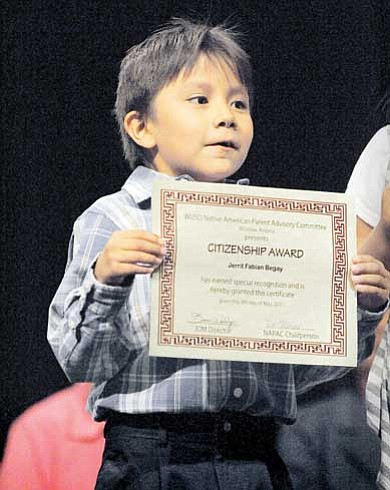 Jerrit Fabian Begay with his award for citizenship.