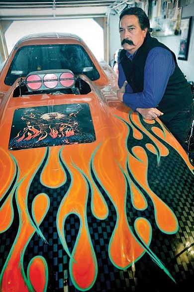 "Todd Roth/NHO<br> Charles McLaws with his ""Funny Car."" The car achieves 220 mile per hour in the quarter mile."