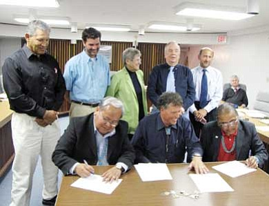 Submitted photo<br> From left to right are (standing) Cortez City Councilman Bob Archibeque, Mayor Pro Tem Matt Keefauver, Betty Swank, Tom Butler, Robert Rime; seated in the back is Cortez City Attorney Mike Green; seated in front from left to right are Navajo Nation Speaker Johnny Naize, Cortez Mayor Dan Porter and Navajo Nation Human Rights Commission Chairperson Duane H. Yazzie. Honorable Naize, Mayor Porter and NNHRC Chairperson Yazzie signed an MOA to address Navajo race relations on May 24 in Cortez, Colo.