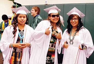 Photo/W.H. Begay<br> Tuba City High School graduate Jennifer Williams with family members after the Warrior Graduation on May 21.