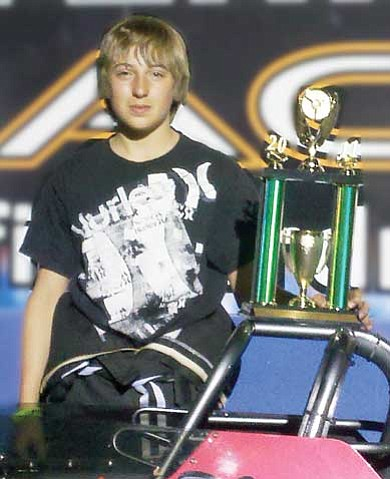 Todd Roth/NHO<br> Hayden Walton proudly displays a trophy he won March 5 at Firebird International Raceway in Chandler. Walton died after he was injured during a Little League game on May 31.