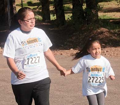 Photo/John Running<br> Just Move It! participants walk in the 28th Annual Sacred Mountain Prayer Run in Flagstaff on June 4.