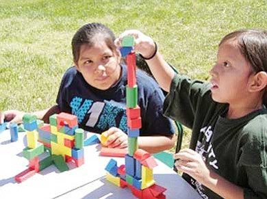 Submitted photo<br> Keneisha and Quanoah Yazzie of Tuba City enhance their math skills with building blocks at the First Things First Family Fun Day.""